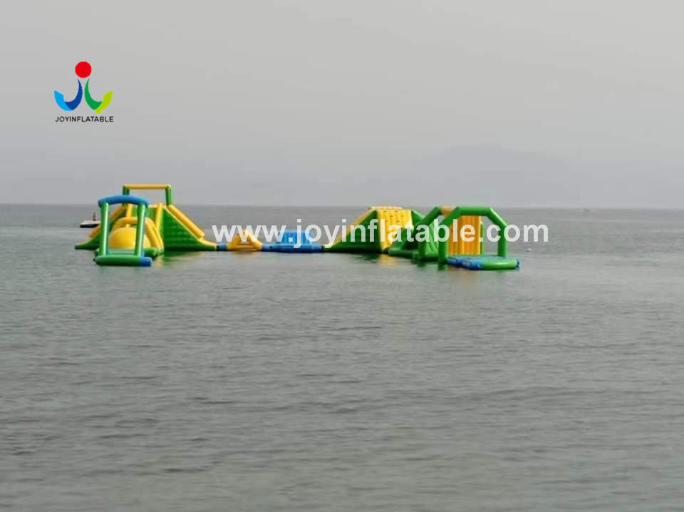 Joyinflatable The Biggest Inflatable Floating Water Sport Park With Jumping Platform For Adult Video